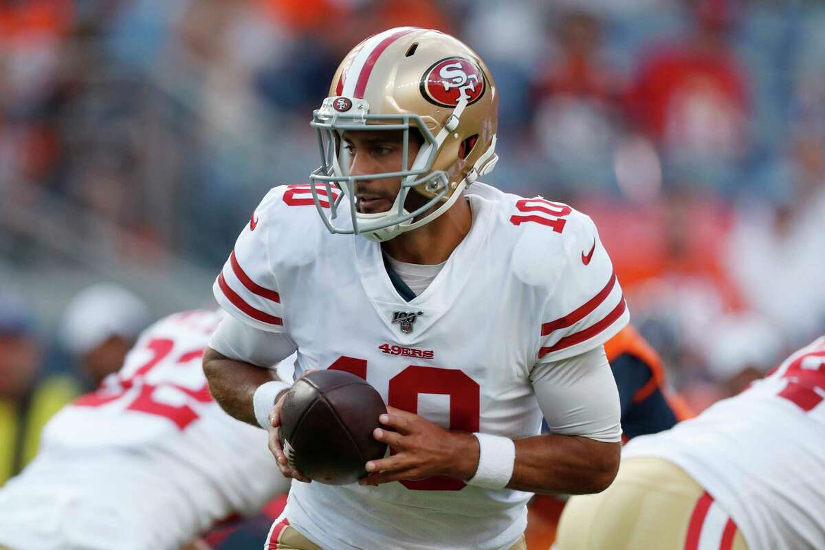 FILE - In this Aug. 19, 2019, file photo, San Francisco 49ers quarterback Jimmy Garoppolo (10) looks to hand the ball off during the first half of the team's NFL preseason football game against the Denver Broncos in Denver.