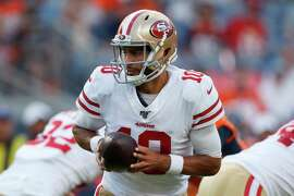 FILE - In this Aug. 19, 2019, file photo, San Francisco 49ers quarterback Jimmy Garoppolo (10) looks to hand the ball off during the first half of the team's NFL preseason football game against the Denver Broncos in Denver. Garoppolo remains a mostly untested commodity with 10 career starts in five seasons and has struggled in training camp and exhibitions. He must show that the Niners made the right choice when they invested in him.
