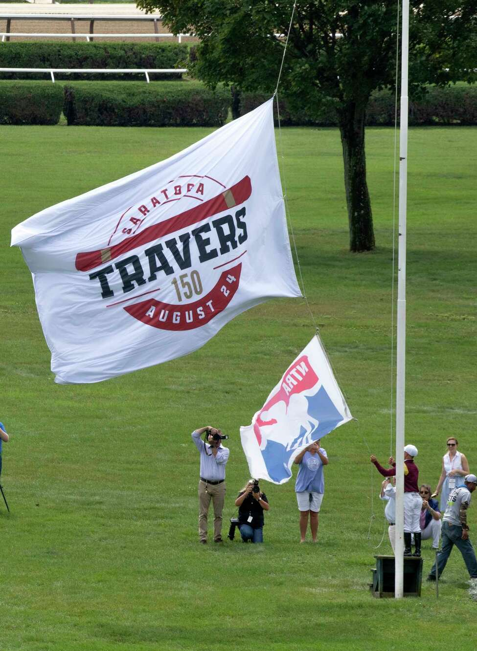 The Travers 150 flag goes up in the infield of the main track at the Saratoga Race Course Thursday Aug. 22, 2019 in Saratoga Springs, N.Y. the flag was hoisted up by last yearA?•s winning jockey Hall of FamerA?•s Javier Castellano and trainer Shug McGuaghey Photo special to the Times Union by Skip Dickstein