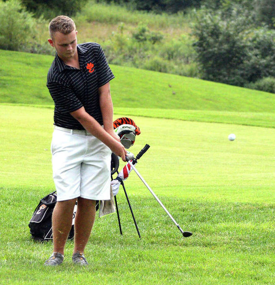 Edwardsville senior Ian Bailey hits a chip shot on hole No. 15 during Thursday's Madison County Tournament at Belk Park Golf Course in Wood River. Photo: Scott Marion/The Intelligencer
