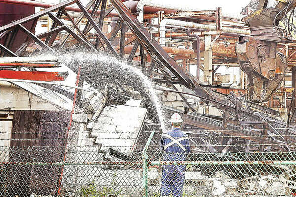 Current work at the Valero refinery in Hartford includes the demolition of structures, like this one Thursday near Hawthorne Avenue, that date back decades to when the refinery was owned by Clark Oil & Refining Co.