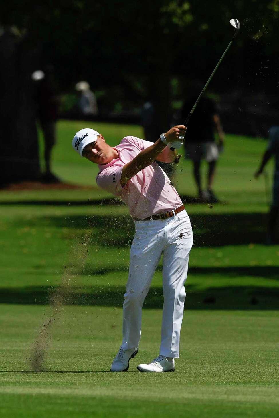 Justin Thomas hits from the third fairway during the first round of the Tour Championship golf tournament Thursday, Aug. 22, 2019, in Atlanta. (AP Photo/John Amis)