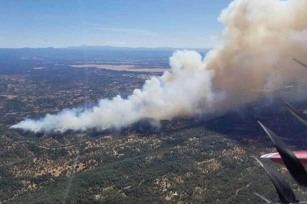 This photo provided by Cal Fire shows an aerial view of the Mountain Fire burning Thursday, Aug. 22, 2019, near Redding, Calif. A fast-moving Northern California wildfire is threatening thousands of homes and forcing evacuations. The fire in Shasta County started around noon in a rural area northwest of Redding about 200 miles (320 kilometers) north of San Francisco. CalFire Capt. Robert Foxworthy says the blaze quickly spread to more than 600 acres, or about one square mile. Foxworthy says about 2,000 structures may be threatened, though officials haven't conducted a thorough count yet. (Cal Fire via AP)