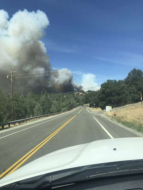 This photo provided by Cal Fire shows the Mountain Fire burning Thursday, Aug. 22, 2019, near Redding, Calif. A fast-moving Northern California wildfire is threatening thousands of homes and forcing evacuations. The fire in Shasta County started around noon in a rural area northwest of Redding about 200 miles (320 kilometers) north of San Francisco. CalFire Capt. Robert Foxworthy says the blaze quickly spread to more than 600 acres, or about one square mile. Foxworthy says about 2,000 structures may be threatened, though officials haven't conducted a thorough count yet. (Cal Fire via AP) Photo: Associated Press