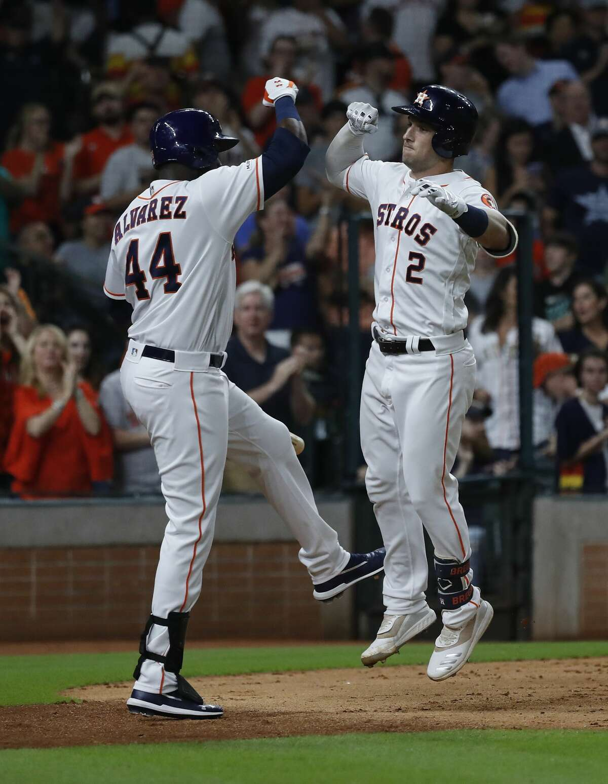 Houston Astros Alex Bregman (2) celebrates wth Yordan Alvarez (44) after hitting a two-run home run in the fourth inning of an MLB game at Minute Maid Park, Thursday, August 22, 2019.