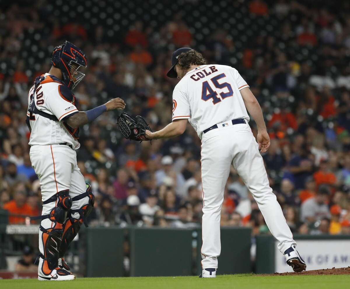 Houston Astros starting pitcher Gerrit Cole (45) chats with catcher Martin Maldonado (12) in the sixth inning of an MLB game at Minute Maid Park, Thursday, August 22, 2019.