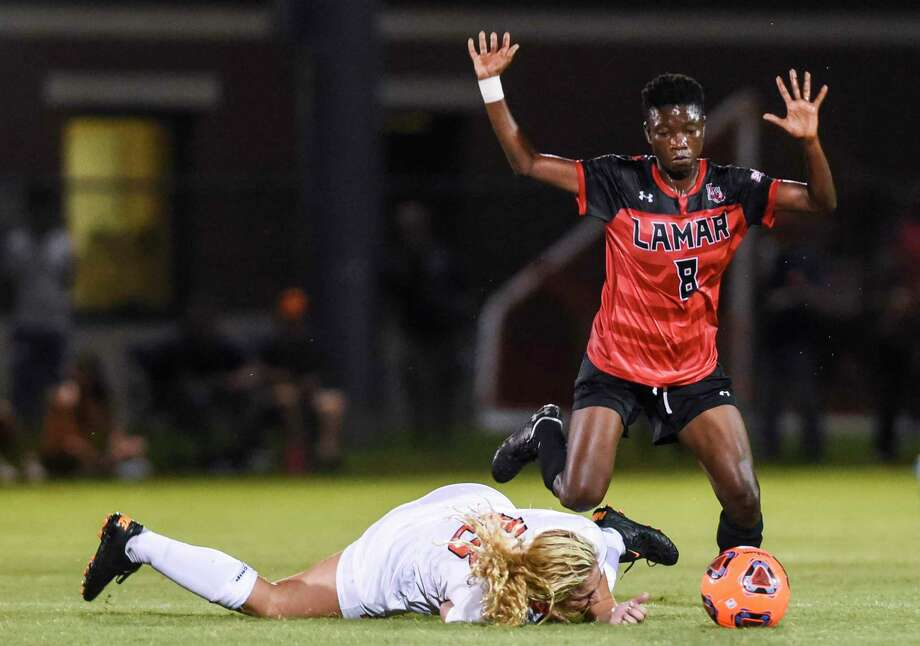 Lamar's Wasila Diwura throws her hands up as OSU's Camy Huddleston falls to the ground during the second half of game at Lamar Thursday night  Photo taken on Thursday, 08/22/19. Ryan Welch/The Enterprise Photo: Ryan Welch, Beaumont Enterprise / The Enterprise / © 2019 Beaumont Enterprise