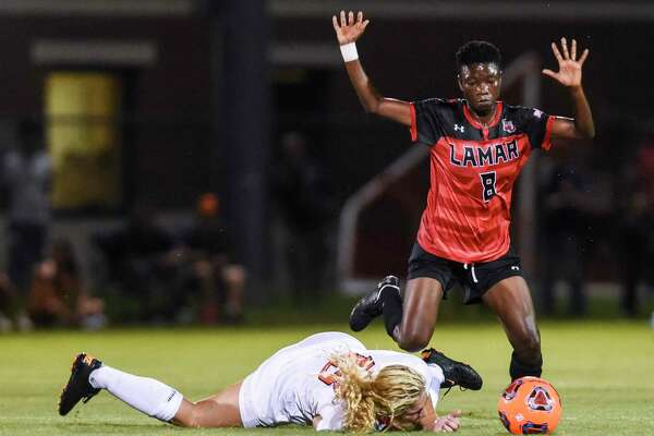 Lamar's Wasila Diwura throws her hands up as OSU's Camy Huddleston falls to the ground during the second half of game at Lamar Thursday night Photo taken on Thursday, 08/22/19. Ryan Welch/The Enterprise
