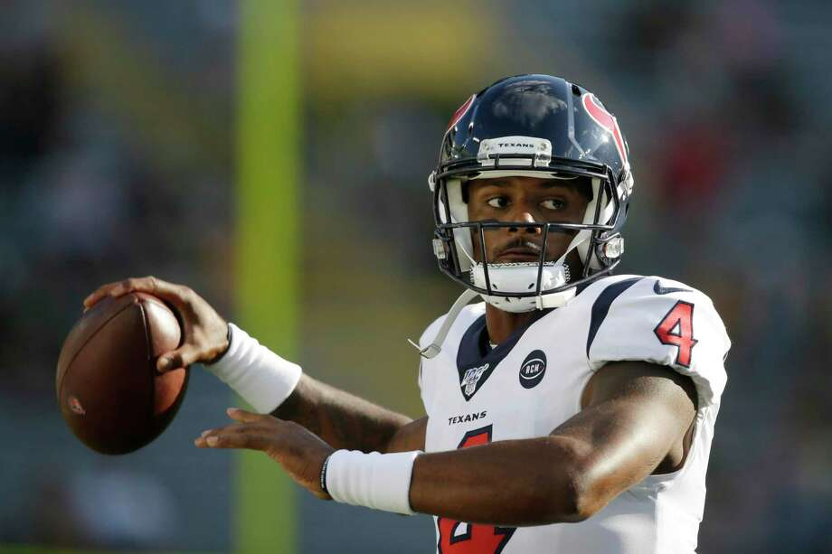 FILE - In this Thursday Aug. 8, 2019, file photo, Houston Texans quarterback Deshaun Watson warms up before the start of an NFL preseason football game against the Green Bay Packers in Green Bay, Wis. The Texans are without a general manager while coach Bill O'Brien works to improve an 11-6 record and find a way to win in the postseason after Indianapolis beat Houston on its own field. (AP Photo/Jeffrey Phelps, File) Photo: Jeffrey Phelps, FRE / Associated Press / Copyright 2019 The Associated Press. All rights reserved.