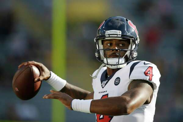 FILE - In this Thursday Aug. 8, 2019, file photo, Houston Texans quarterback Deshaun Watson warms up before the start of an NFL preseason football game against the Green Bay Packers in Green Bay, Wis. The Texans are without a general manager while coach Bill O'Brien works to improve an 11-6 record and find a way to win in the postseason after Indianapolis beat Houston on its own field. (AP Photo/Jeffrey Phelps, File)