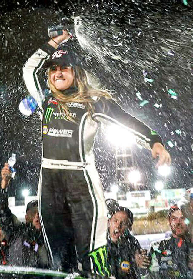 Hailie Deegan celebrates after she spun teammate Derek Kraus on the final lap of the overtime restart and won her third career NASCAR Pro Series West race June 9 in Colorado. Deegan and Kraus will race Saturday in the NASCAR K&N Pro Series race at World Wide Technology Raceway in Madison. Photo: Meg Oliphant, NASCAR