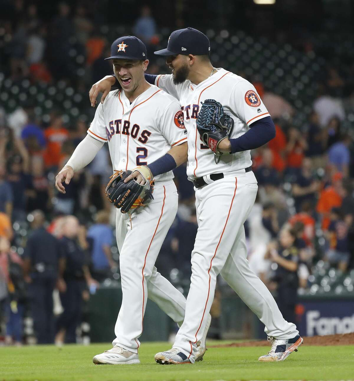 Houston Astros Alex Bregman (2) and Roberto Osuna (54) hug as they walk back to the dugout after an MLB game at Minute Maid Park, Thursday, August 22, 2019. Astros won 6-3.