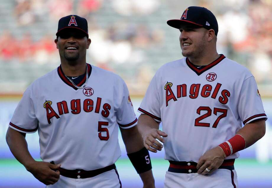 Their jerseys last Saturday in Anaheim literally made Angels stars Albert Pujols, left, and Mike Trout a pair of throwback players. Photo: Marcio Jose Sanchez, STF / Associated Press / Copyright 2019 The Associated Press. All rights reserved.