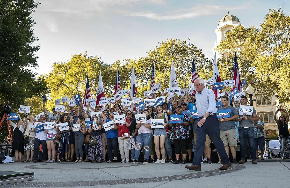 Democratic presidential hopeful Sen. Bernie Sanders walks by supporters to the podium while campaigning at Cesar Chavez Plaza on Thursday, Aug. 22, 2019, in Sacramento, Calif. (Paul Kitagaki Jr./The Sacramento Bee via AP)