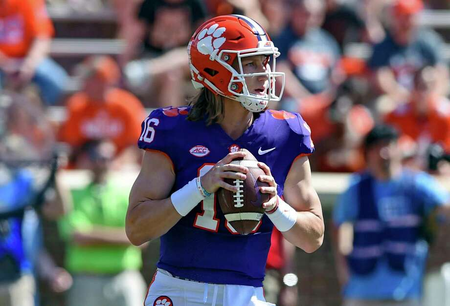 FILE - In this April 6, 2019, file photo, Clemson's Trevor Lawrence drops back to pass during Clemson's annual Orange and White NCAA college football spring scrimmage in Clemson, S.C. After leading Clemson to a national championship as a freshman, Lawrence was selected an AP preseason All-American by poll voters. (AP Photo/Richard Shiro, File) Photo: Richard Shiro / FR159523 AP