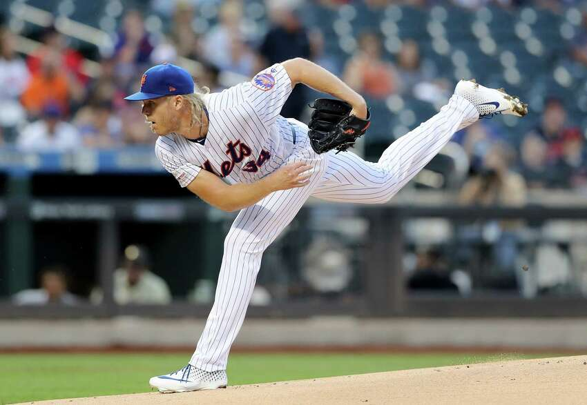NEW YORK, NEW YORK - AUGUST 22: Noah Syndergaard #34 of the New York Mets delivers a pitch in the first inning against the Cleveland Indians at Citi Field on August 22, 2019 in the Flushing neighborhood of the Queens borough of New York City. (Photo by Elsa/Getty Images)