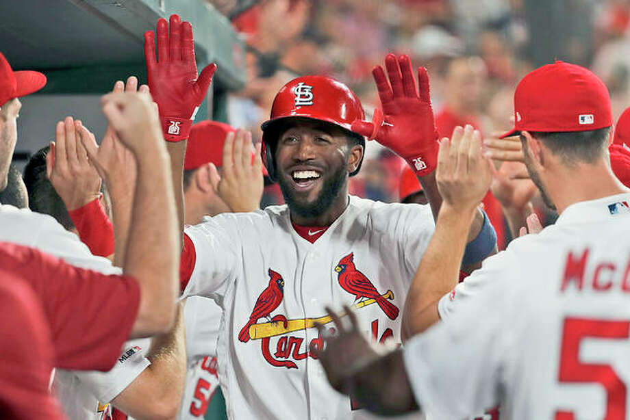 The Cardinals' Dexter Fowler is congratulated by teammates after hitting a two-run home run in the seventh inning of Thursday night's win over the Colorado Rockies at Busch Stadium. Photo: AP Photo