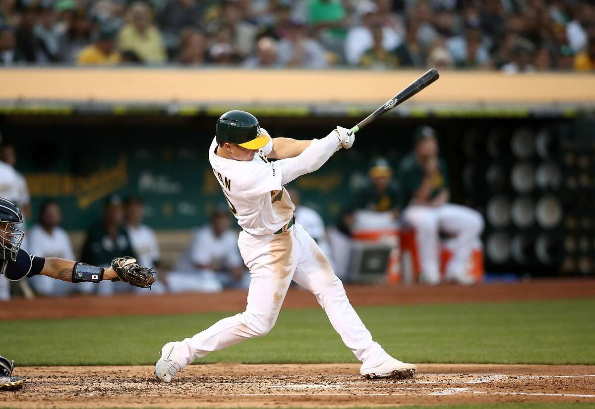 OAKLAND, CALIFORNIA - AUGUST 22: Matt Chapman #26 of the Oakland Athletics hits a single that scored a run in the third inning against the New York Yankees at Ring Central Coliseum on August 22, 2019 in Oakland, California. (Photo by Ezra Shaw/Getty Images)