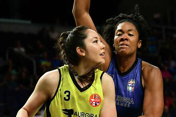 Team World's Joy Burke, left, is guarded by Team Americas' Krystal Thomas during a basketball game in the Aurora Games at the Times Union Center on Tuesday, Aug. 20, 2019 in Albany, N.Y. (Lori Van Buren/Times Union)