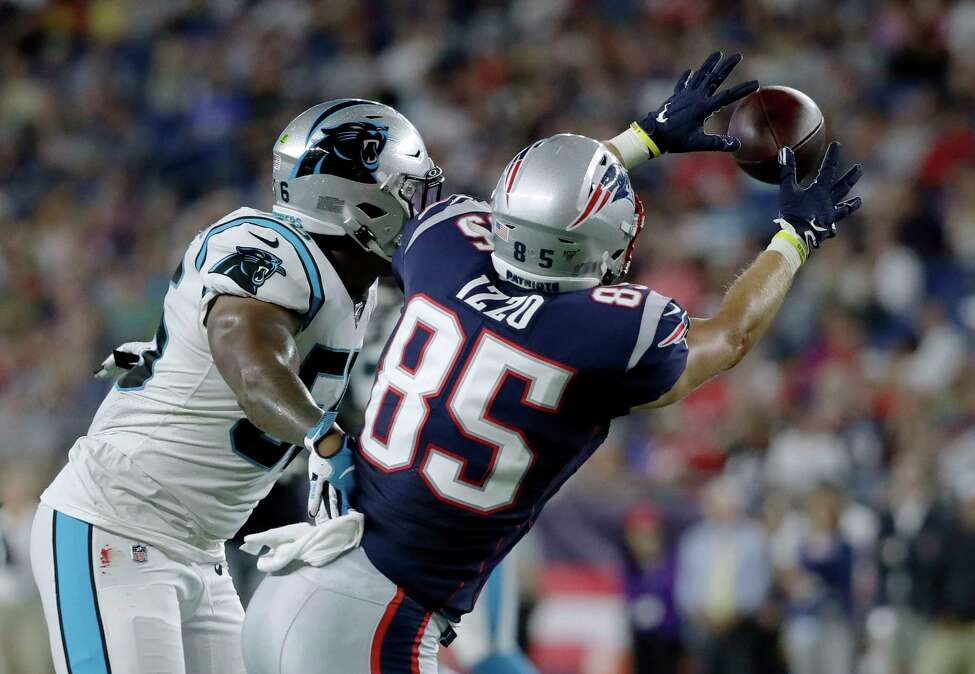 New England Patriots tight end Ryan Izzo (85) catches a pass in front of Carolina Panthers linebacker Jermaine Carter (56) in the first half of an NFL preseason football game, Thursday, Aug. 22, 2019, in Foxborough, Mass. (AP Photo/Elise Amendola)