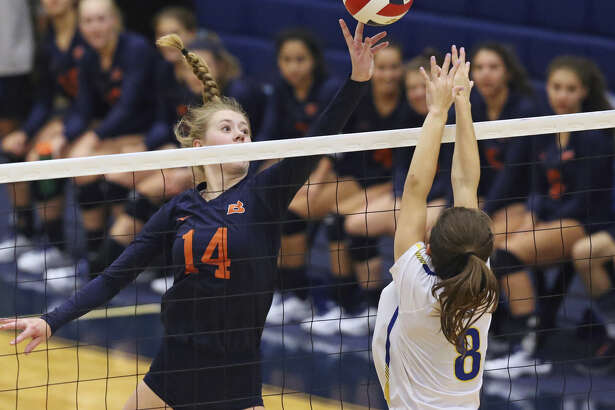 Brandeis' Emma Halstead dinks a shot over Alamo Heights' Ruby O'Brien at Taylor Field House.