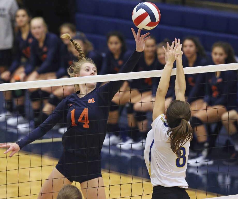 Brandeis' Emma Halstead dinks a shot over Alamo Heights' Ruby O'Brien at Taylor Field House. Photo: Tom Reel