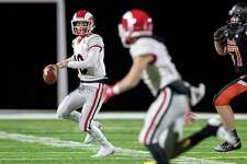 New Canaan QB Drew Pyne (10) looks to make a pass down field during the Rams' win over Shelton in the Class LL quarterfinals on November 27, 2018.