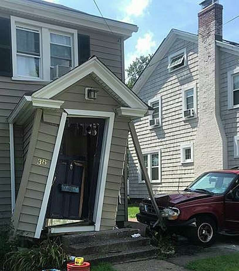 A motor-vehicle crashed into the front on a Hamden house on Thursday, Aug. 22, 2019. The Hamden Fire Department said there were no injuries reported. Photo: Hamden Fire Department Photo