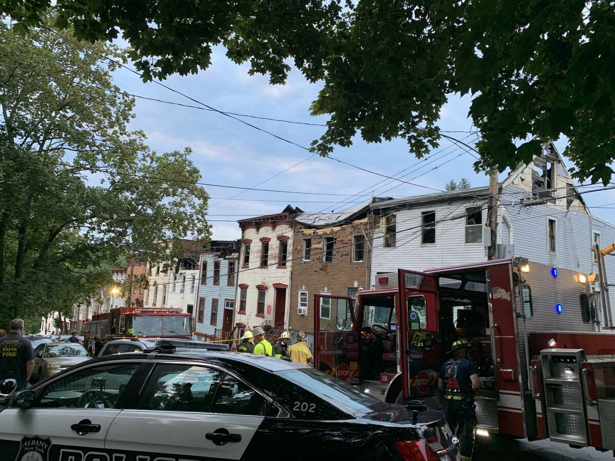 Fire spread to four row houses on Myrtle Avenue, routing more than 30 people from homes less than two blocks from the governor's mansion in downtown Albany.