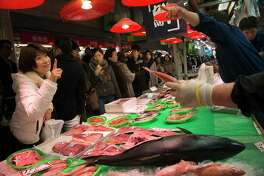Shoppers browse f seafood and produce at the Omi-Cho market in Kanazawa, Japan, on Jan. 8, 2016.