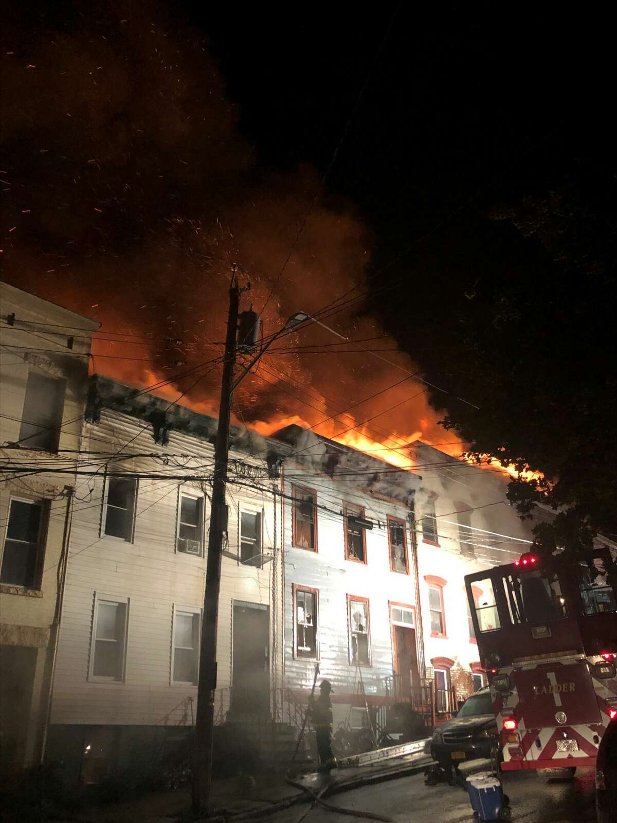 Afire on Myrtle Avenue in Albany overnight Aug. 22-23, 2019, engulfed several row houses near the governor's mansion and left more than 30 people homeless. (Photo by Rose Mitchell-Tenerowicz)