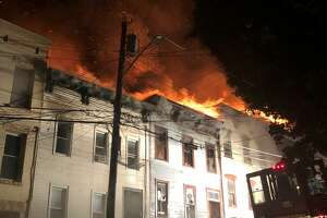 A fire on Myrtle Avenue in Albany overnight Aug. 22-23, 2019, engulfed several row houses near the governor's mansion and left more than 30 people homeless. (Photo by Rose Mitchell-Tenerowicz)