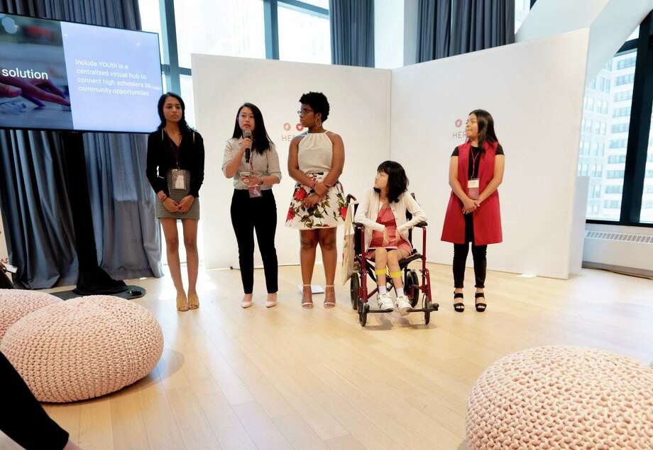 Riya Krishnan and a team member pitching Wavve at the 2019 Ann Taylor HERlead leadership forum in New York City this past June. The other three girls were other HERlead fellows that were pitching their organizations. Photo: Riya Krishnan