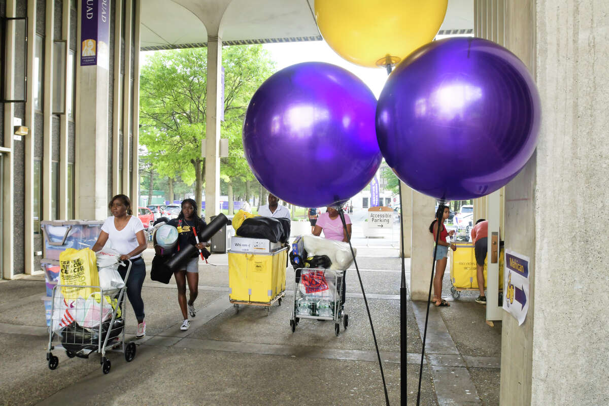 University at Albany freshman students along with their family members begin moving in their belongings to the dorms on Thursday, Aug. 22, 2019, in Albany, N.Y. (Paul Buckowski/Times Union)