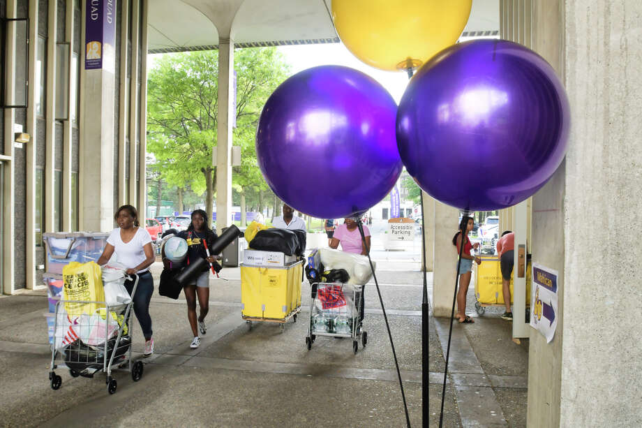 University at Albany freshman students along with their family members begin moving in their belongings to the dorms on Thursday, Aug. 22, 2019, in Albany, N.Y.     (Paul Buckowski/Times Union) Photo: Paul Buckowski / (Paul Buckowski/Times Union)