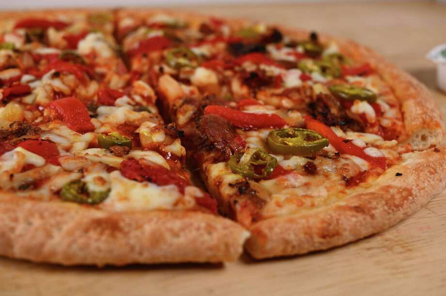 Papa John's Houston and Killen's Barbecue of Pearland have teamed for a second pizza collaboration: Killen's Pulled Pork Pizza, available Aug. 26 through Sept. 29, 2019. Photo: Al Torres Photography