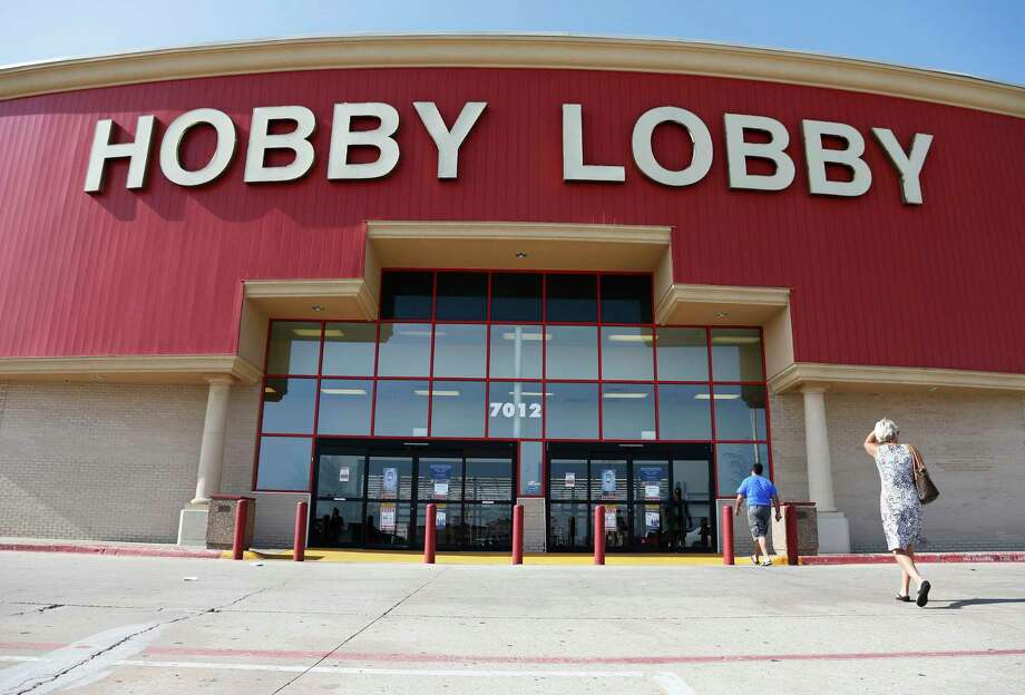 Customers walk to a Hobby Lobby store in Oklahoma City, Monday, June 30, 2014. The Supreme Court ruled Monday that employers can hold religious objections that allow them to opt out of the new health law requirement that they cover contraceptives for women. The Hobby Lobby chain of arts-and-crafts stores is by far the largest employer of any company that has gone to court to fight the birth control provision. (AP Photo/Sue Ogrocki) Photo: Sue Ogrocki / AP / AP