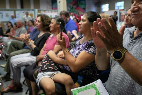 STAMFORD, CONNECTICUT - AUGUST 12: People applaud at town-hall style event held to reassure the nervous local immigrant community on August 12, 2019 in Stamford, Connecticut. State and local government leaders listened as immigrants spoke of their fears in an atmosphere of racially-charged tweets from President Trump and following the El Paso mass shooting, which targeted people of Mexican heritage. Officials reassured them they would continue to receive support in the state Connecticut, even as the federal government pursues the President's anti-immigrant agenda. The event was held at the Building One Community immigrant center in Stamford. (Photo by John Moore/Getty Images)