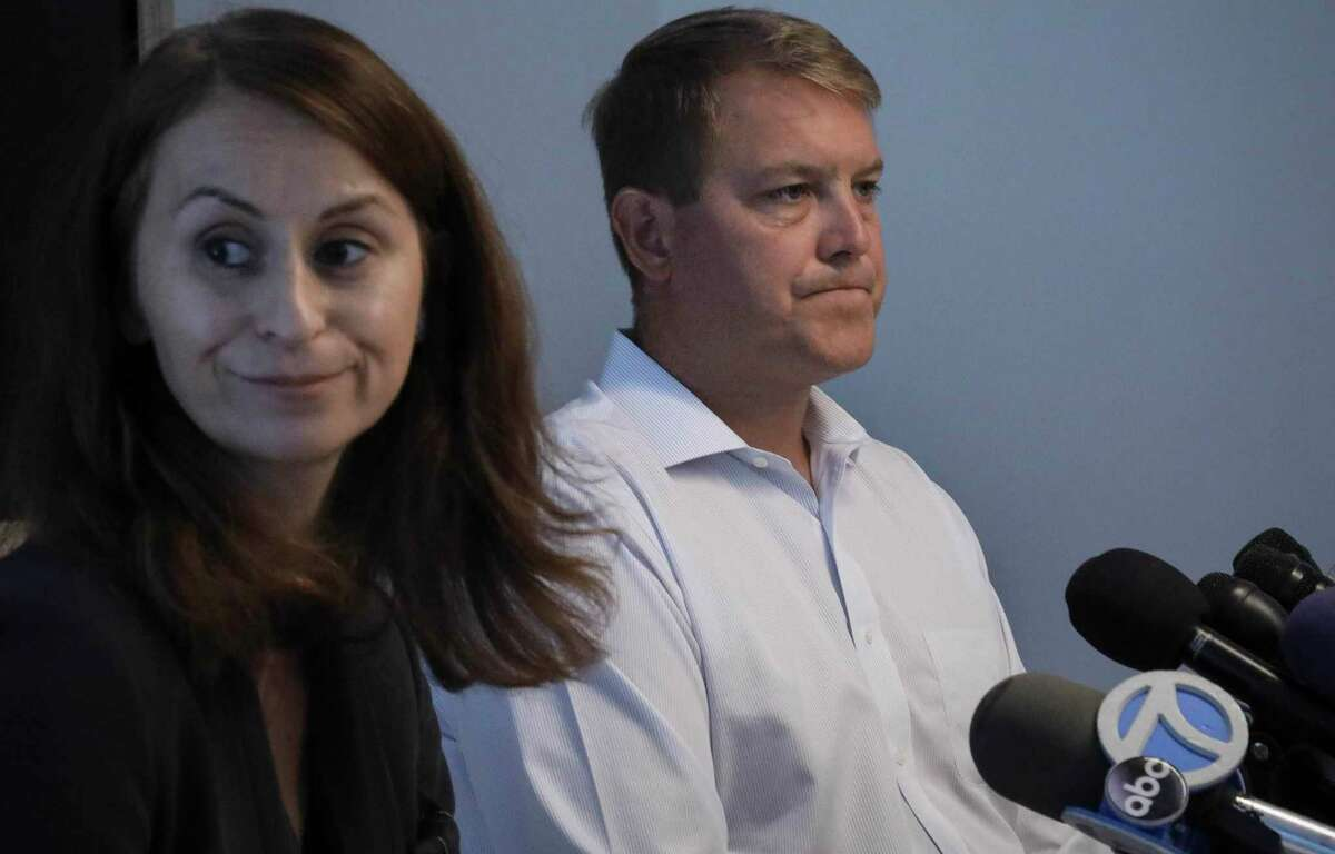 Scott Hapgood, right, a U.S. financial adviser charged with killing a hotel worker while on vacation in Anguilla, and his lawyer Juliya Arbisman, left, hold a press conference, Tuesday Aug. 20, 2019, in New York. The case has sparked racial tensions on the Caribbean island that caters to wealthy tourists, and some Anguillans are demanding that Hapgood return to face justice in the British territory of nearly 15,000 people. (AP Photo/Bebeto Matthews)