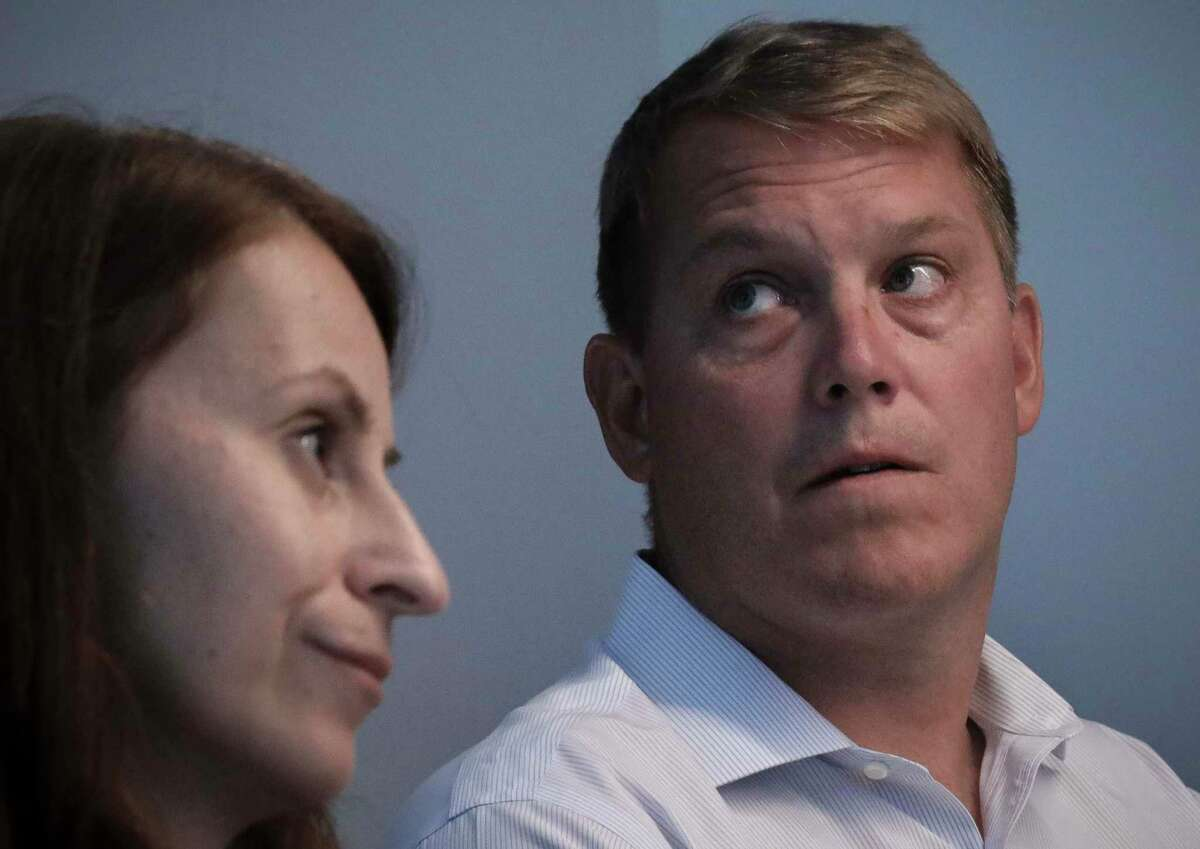 Scott Hapgood, right, and his lawyer Juliya Arbisman hold a press conference, Tuesday, Aug. 20, 2019, in New York.