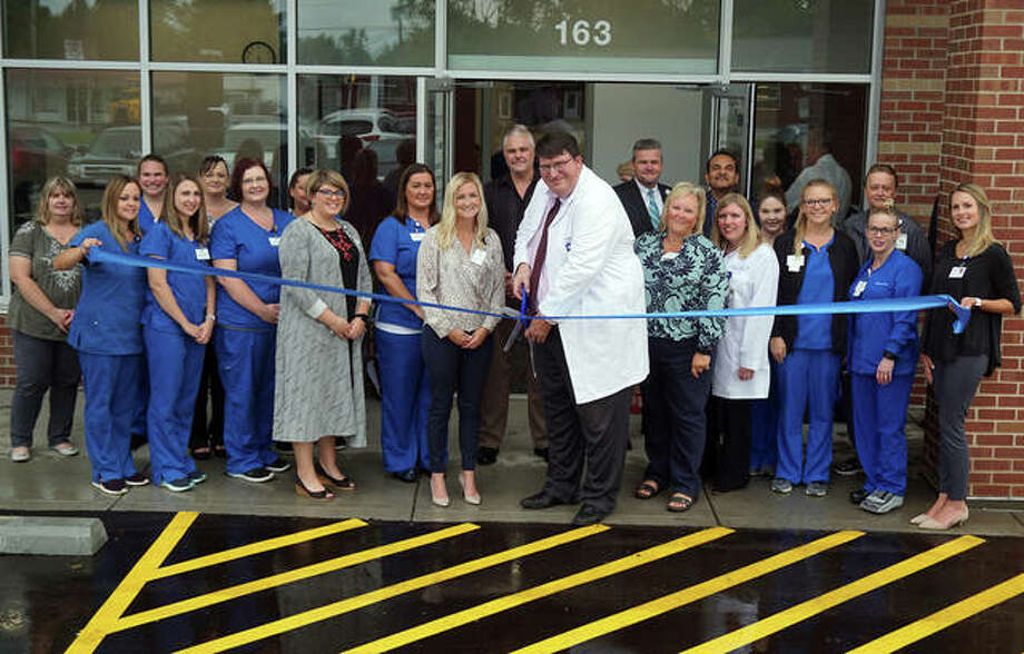 Dr. Craig Harms, center, cuts the ribbon on the new BJC Medical Group office building in Bethalto on Aug. 22, surrounded by the staff of Family Physicians of Bethalto, Alton Memorial Convenient Care at Bethalto and the Network Reference Lab.