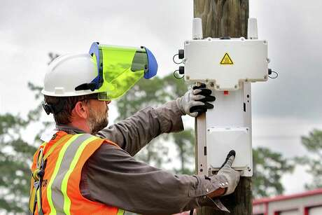 Entergy Texas crews install a transmitter on a pole in the network. Entergy is one of dozens of power companies in Houston you can peek at as you scroll through over 100 electricity plans on PowertoChoose.