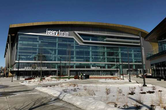 The Fiserv Forum, Milwaukee's new downtown arena that opened in the summer of 2018, is seen on Monday, March 11, 2019. Democrats picked Milwaukee on Monday to host their 2020 national convention, setting up the party's standard-bearer to accept the presidential nomination in the heart of the old industrial belt that delivered Donald Trump to the White House. Democratic Party proceedings will play out in the 17,500-seat arena that Republican Wisconsin Gov. Scott Walker helped build for the NBA's Milwaukee Bucks by securing public financing from state lawmakers. (AP Photo/Carrie Antlfinger)