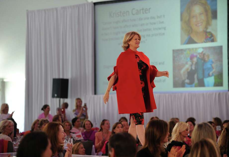 Breast cancer survivor Kristen Carter takes her turn on the catwalk during the Breast Cancer Alliance Annual Luncheon and Fashion Show at the Hyatt Regency Hotel in Greenwich, Conn. on Tuesday, October 30, 2018. Photo: Brian A. Pounds / Hearst Connecticut Media / Connecticut Post