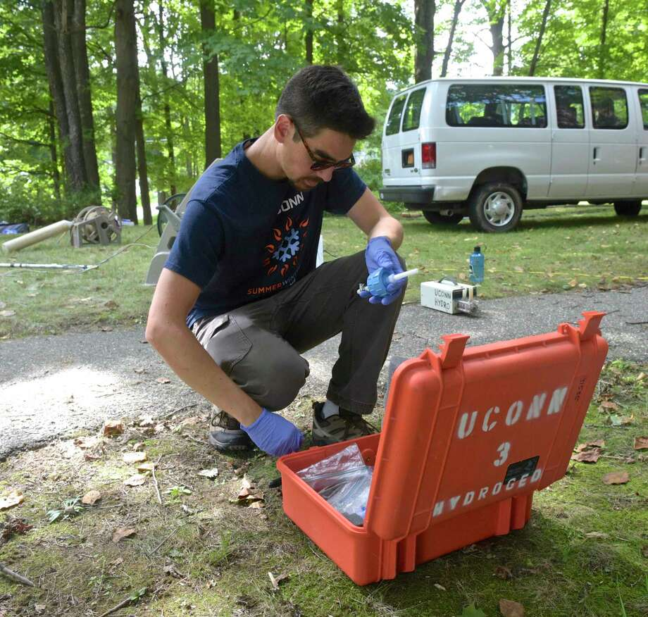 University of Connecticut phd candidate Mark Higgins puts together a water filter to run a water quality test. A group of university researchers are working on a UCONN project to determine why the water in town-owned wells in Sherman has a high level of sodium. Tuesday, August 21, 2018, in Sherman, Conn. Photo: H John Voorhees III / Hearst Connecticut Media / The News-Times