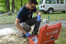 University of Connecticut phd candidate Mark Higgins puts together a water filter to run a water quality test. A group of university researchers are working on a UCONN project to determine why the water in town-owned wells in Sherman has a high level of sodium. Tuesday, August 21, 2018, in Sherman, Conn.
