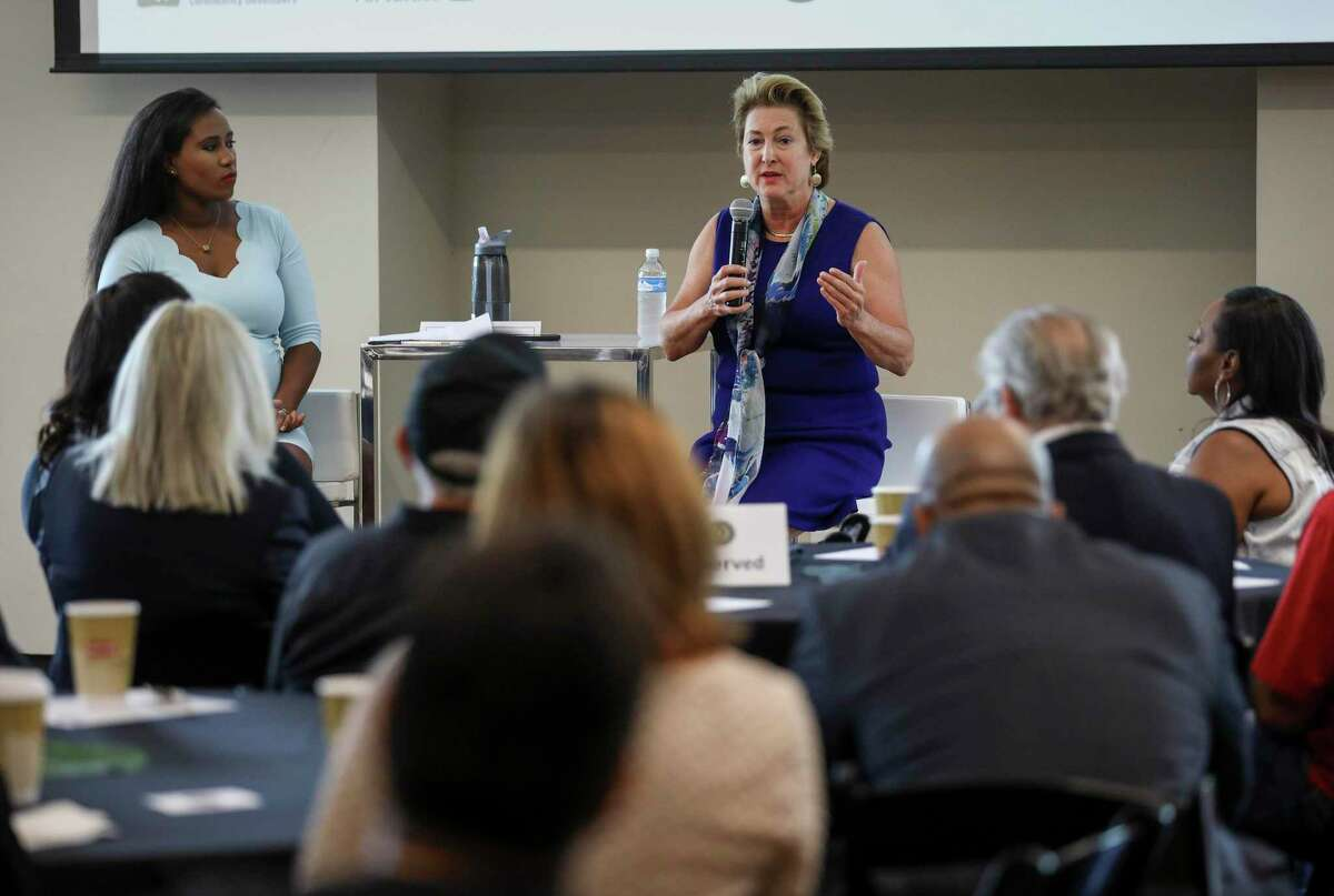 Harris County District Attorney Kim Ogg, rear right, speaks during a community meeting on Saturday, Aug. 10, 2019, in Houston.