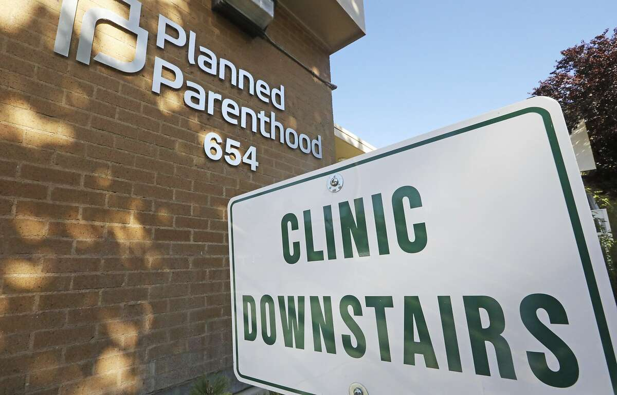 A sign is displayed at Planned Parenthood of Utah Wednesday, Aug. 21, 2019, in Salt Lake City. About 39,000 people received treatment from Planned Parenthood of Utah in 2018 under a federal family planning program called Title X. The organization this week announced it is pulling out of the program rather than abide by a new Trump administration rule prohibiting clinics from referring women for abortions. (AP Photo/Rick Bowmer)