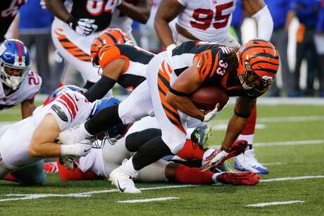 Cincinnati Bengals running back Rodney Anderson (33) runs the ball during the first half of an NFL preseason football game against the New York Giants, Thursday, Aug. 22, 2019, in Cincinnati. (AP Photo/Frank Victores)