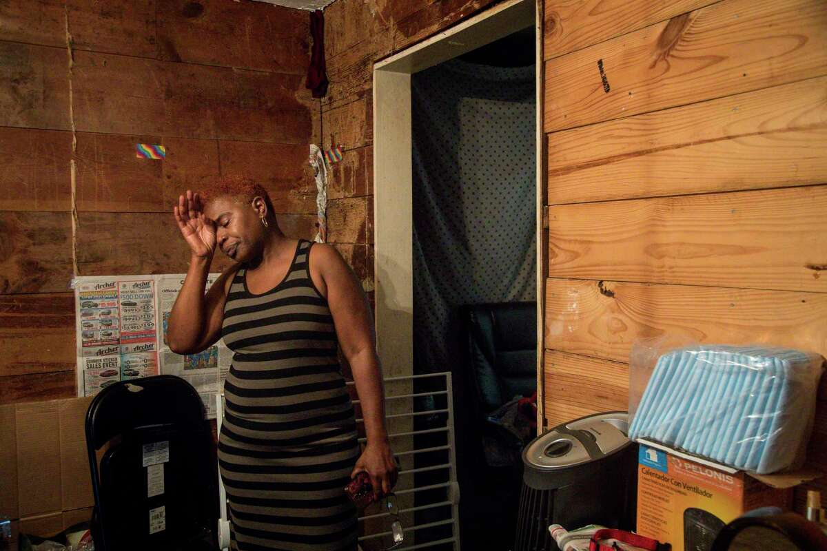 """""""It's hell to be poor,"""" said Sandra Edwards as she cried in her home on Thursday, Aug. 15, 2019, in Houston. """"I work seven days a week to keep from being at home."""" Edwards said her home flooded in 2016 and again during Hurricane Harvey."""